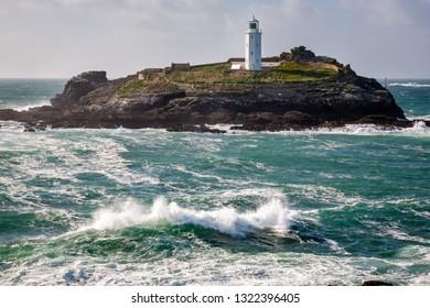 Storm waves crashing at Godrevy Island Cornwall England UK Europe