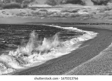 storm waves hitting Beach at Portland in south-west England.