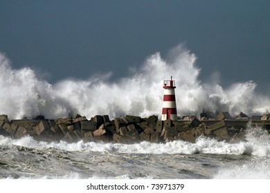 Storm waves over beacon of the harbor of Povoa do Varzim, Portugal