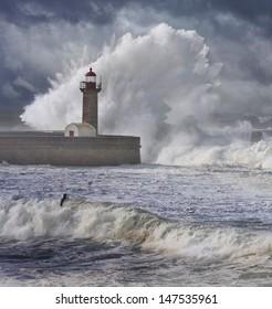 Storm waves over the Lighthouse, Portugal - enhanced blue sky