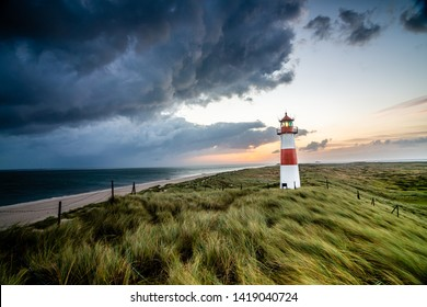 Stormclouds at Lighthouse in List on the island of Sylt, Schleswig-Holstein, Germany