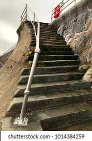 storm-damaged steps to beach
