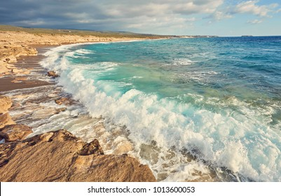 Storming sea and wide-spreading waves, Cyprus coastline.