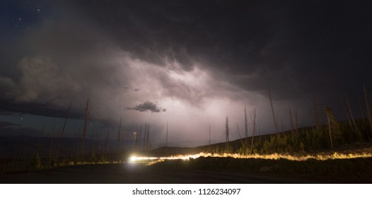 Storms brew fast and move over the landscape in Yellowstone generating rain and electricity some stars still viewable