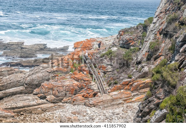 STORMS RIVER MOUTH, SOUTH AFRICA - MARCH 1, 2016:  Unidentified hikers on the staircase at Guano Cave on the Waterfall trail which also is part of the renowned Otter trail