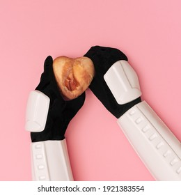 Stormtrooper hands are offering heart covered in raw meat on a pink background. Give a present concept.