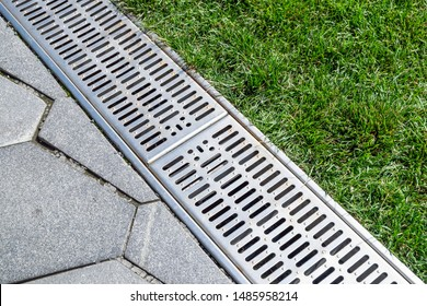 Stormwater drainage on city streets, street separation stormwater drainage, for drainage and separation of water from lawn and pavement. Drainage system for meltwater, rainwater flows and floods