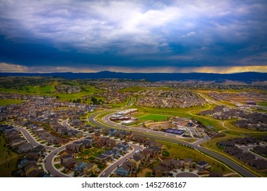 A stormy afternoon sky in Castle Rock, Colorado over suburban neighborhood