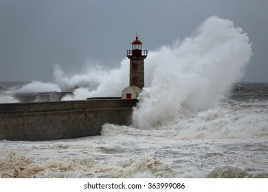Stormy big wave over south piers and  lighthouses of river Douro harbor entry, north of Portugal