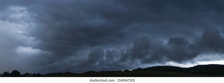 a stormy blue sky over hills