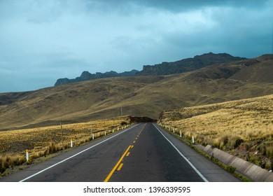 stormy clouds above altitude mountain driveway in Peru