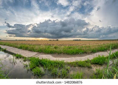 Stormy clouds over the dutch landscape. Fisheye view.