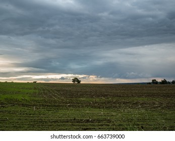 Stormy Clouds Over Farm Field