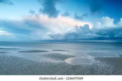 stormy clouds over North sea coast, Netherlands