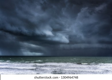 stormy clouds and rain on the sea