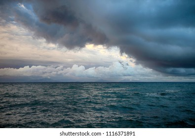 Stormy clouds in the sky above the sea. Evening seascape