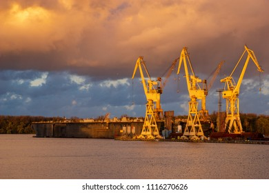 stormy clouds at sunset above the shipyard, repair yard in Szczecin