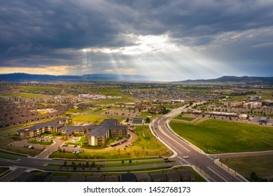 A stormy cloudy afternoon in Castle Rock, Colorado with sun rays