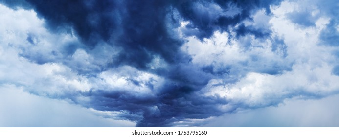 Stormy cloudy sky panorama, dramatic dark blue thunderclouds, gale clouds, thunderstorm landscape wide format, overcast weather, hurricane cloudiness skies, tornado, cloudscape, panoramic heaven view