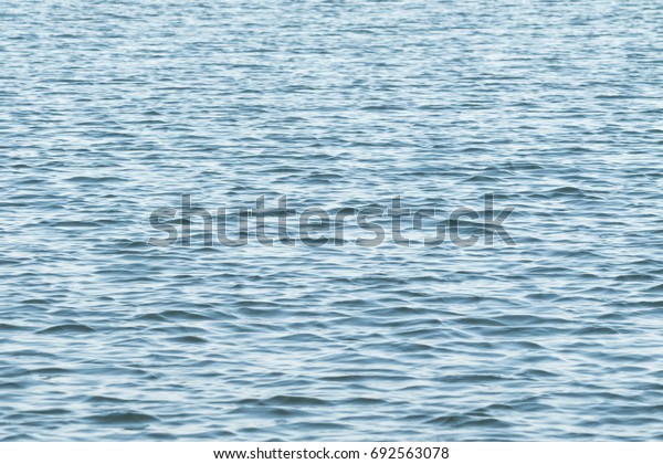 Stormy current on water background