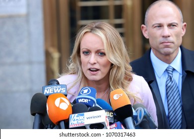 Stormy Daniels and Michael Avenatti hold a press conference after leaving federal court on April 16, 2018, in New York.