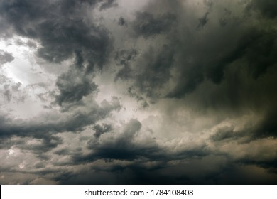 stormy gray leaden sky with heavy cumulus clouds. creative background for harsh dramatic concept design or decoration