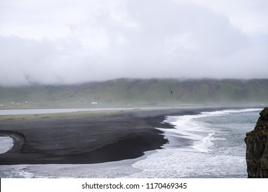 Stormy, moody day on black sand beach Reynisfjara on the south of Iceland, Europe, huge waves on Atlantic Ocean