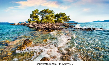 Stormy morning view of small islet on the Adriatic sea. Picturesque summer scene of Sjekirica beach, Croatia, Europe. Beautiful world of Mediterranean countries. Traveling concept background.