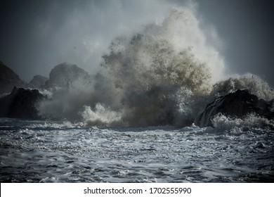 Stormy sea. Big wave crashing.