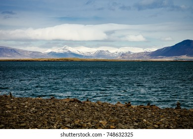 Stormy sea and snowy mountains in the Iceland.