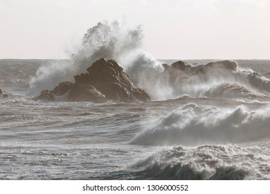 Stormy sea waves crashing over cliffs from northern portuguese coast