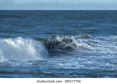 Stormy sea waves with splashes