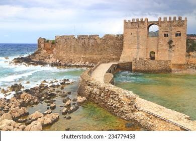 Stormy sea waves splashing near Venetian fortress of Methoni, Greece