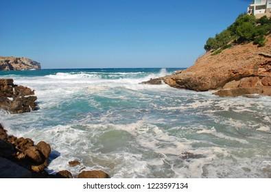 Stormy seas break on Cala Carbo beach at Cala San Vicente on the Spanish island of Majorca.