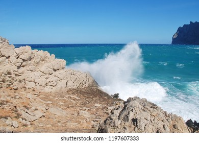 Stormy seas spray over the cliffs by Molins beach at Cala San Vicente on the Spanish island of Majorca.