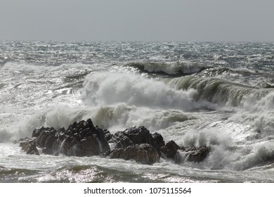 Stormy seascape with breaking waves