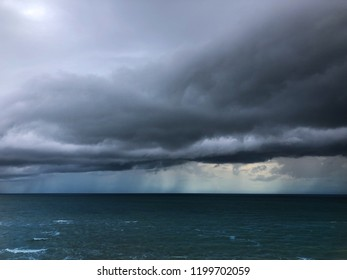 stormy seascape from a cliff/stormy weather on the beach