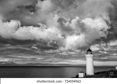 Stormy skies, a black and white landscape of Davaar Island Lighthouse, Campbeltown, Kintyre Peninsula, Scotland