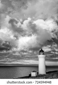 Stormy skies a black and white portrait landscape of Davaar Island Lighthouse, Campbeltown, Kintyre Peninsula, Scotland