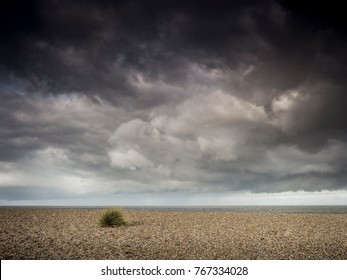 Stormy skies over a shingle beacn in Norfolk.
