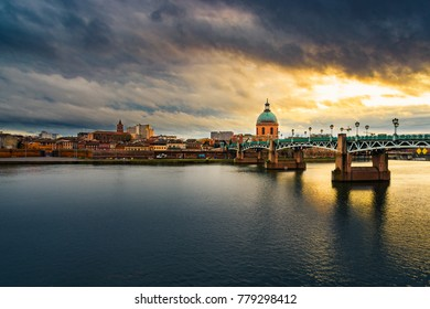 Stormy skies over Toulouse & the Garonne River during golden hour
