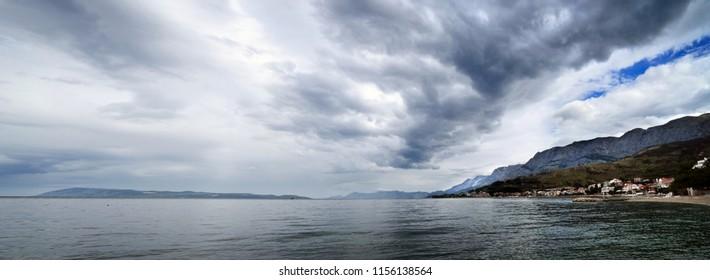 Stormy sky clouds by adriatic sea near Podgora, Croatia