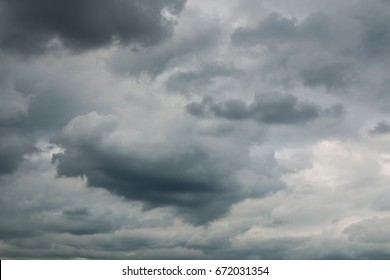 Stormy sky with lots of clouds and in sunny day. Cloudy sky. Dark blue stormy cloudy sky. Dark stormy clouds. Beautiful blue sky background with clouds. Large clouds over getting ready to rain.
