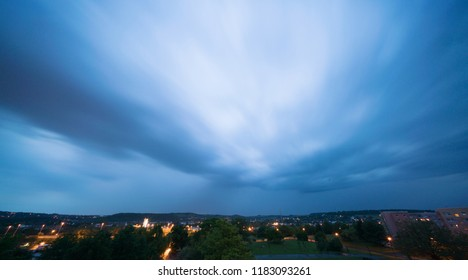 Stormy sky over a city at night