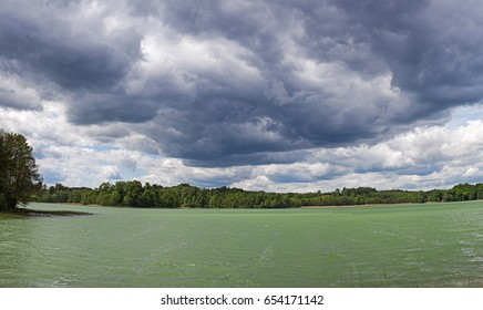 Stormy sky over emerald lake, HDR image, Poland, Europe