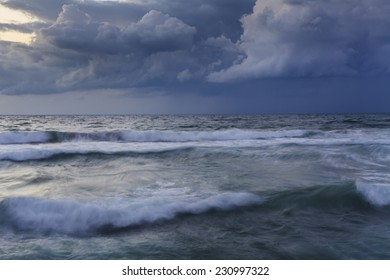 Stormy sky over the wave of the sea.