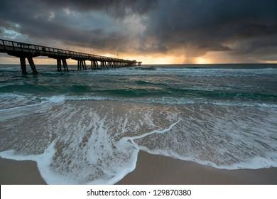 Stormy sunrise on Pompao Beach, Florida, USA.
