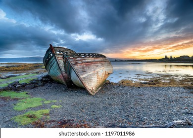 Stormy sunrise over abandoned fishing boats at Salen on the Isle of Mull in Scotland
