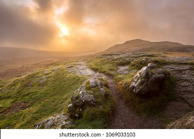 Stormy sunrise Saddle Tor Dartmoor Devon Uk