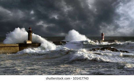 Stormy sunset at the harbor of the mouth of the river Douro, in Porto, Portugal, with big waves against old lighthouse, new pier and beacon; enhanced sky